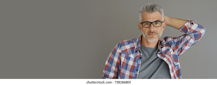 Casual man with grey hair standing on background, isolated- template