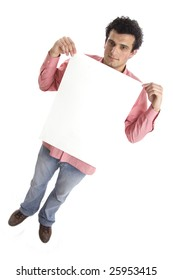 casual man holding an add isolated over a white background