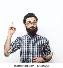 Casual man looking up and pointing his finger to blank space over white background. I have an Idea concept