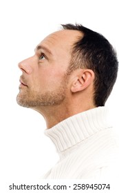 Casual man on white background looking up.
