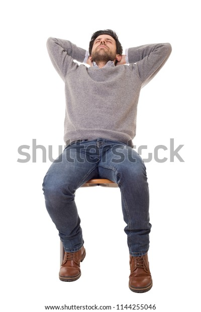casual man sleeping on a chair, isolated on white background