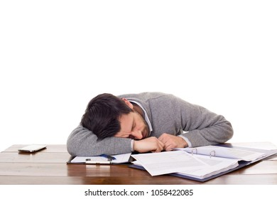 casual man sleeping on a desk, isolated on white background