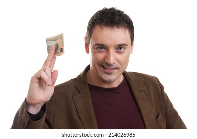 casual man smiling and giving some money isolated over white