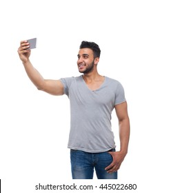 Casual Man Take Selfie Photo On Cell Smart Phone Happy Smile Young Handsome Guy Wear Shirt Jeans Isolated White Background