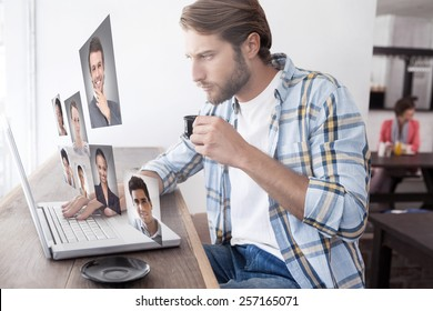 Casual man using laptop drinking espresso against profile pictures