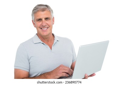 Casual man using a laptop on white background