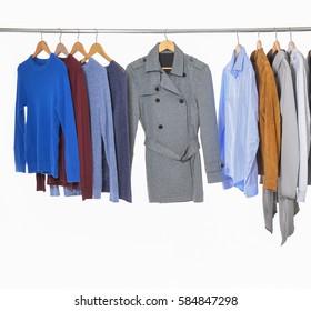 casual men's different suit clothes ,coat, jacket ,coat,trousers, on hangers