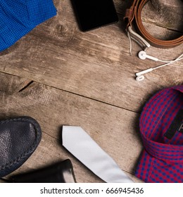Casual mens fashion and outfits on the wooden table, flat lay, top view.