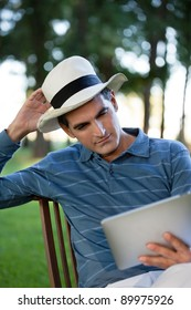 Casual middle aged man looking at tablet PC screen