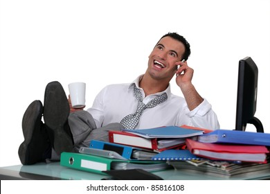 Casual office worker with feet on desk