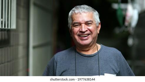 Casual older man laughing at camera. Senior smile feeling happy