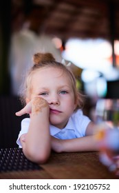 Casual portrait of adorable sad or bored little girl