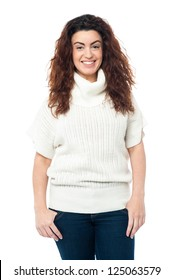 Casual portrait of a fashionable young woman wearing high neck sweater.