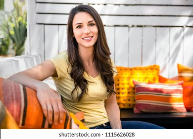 Casual portrait of a pretty woman peaceful and comfortable sitting outside on a bright sunny day