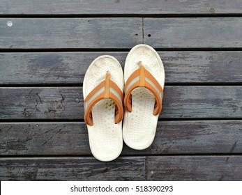 casual sandal on wood floor