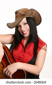 Casual smiling country girl in short sleeve black and red western shirt finished with metal collar tips.