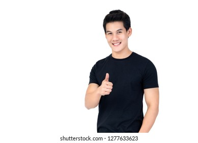 Casual smiling handsome Asian man giving thumbs up studio shot isolated on white background
