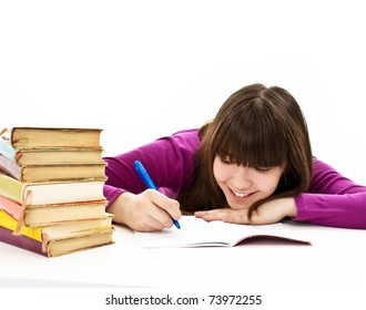 Casual student doing her homework. Isolated on white background.