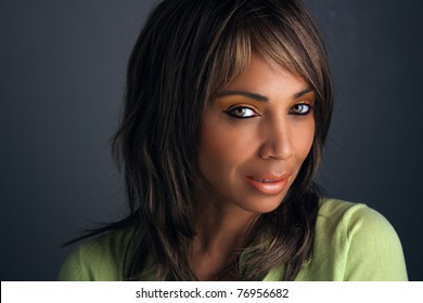 Casual studio close-up of a lovely mature black woman