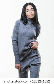 Casual style fashion for every day. Female knitwear. Fashionable knitwear. Knitwear concept. Feel warm and comfortable. Woman wear grey textile suit blouse and pants. Warm comfortable clothes.