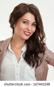 Casual style woman portrait. Smiling girl standing against studio background.