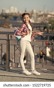 Casual suits her the best. Happy small girl in casual and comfy outfit on urban background. Little cute child smiling in casual style on summer day. Casual and comfortable.