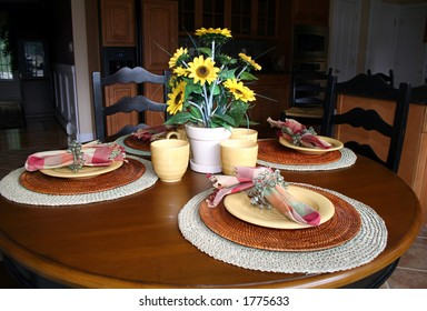 Casual Table Setting In Modern Kitchen; Warm Tones Of Gold And Maroon