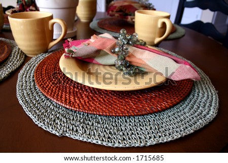 Casual Table Setting In Warm Tones Of Gold And Maroon