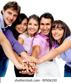 Casual team with their hands together in the middle - isolated over a white background