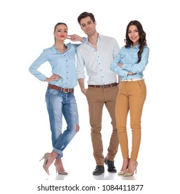 casual team of two confident women and an attractive man in the middle, standing on white background