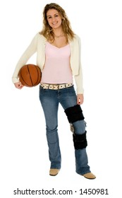 Casual teen girl with basket ball, wearing leg brace.  Full body over white with clipping path.