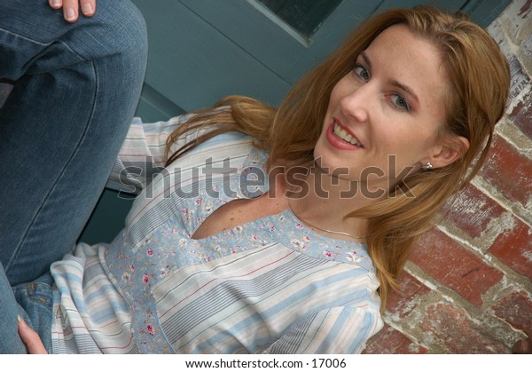 Casual teen smiling in light blue hippy shirt and jeans