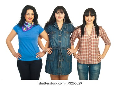 Casual three women friends standing in a row with their hands crossed isolated on white background