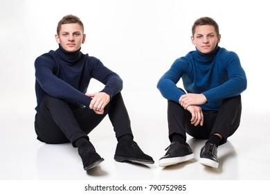 Casual twin brothers. Studio shoton a white background