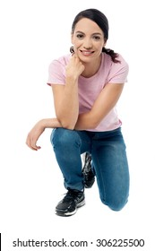 Casual woman crouched down on knees over white
