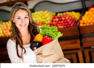 Casual woman grocery shopping and looking happy