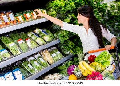 Casual woman grocery shopping at the supermarket