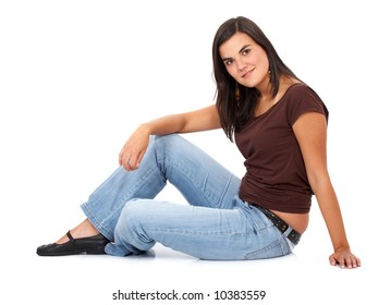 casual woman on the floor smiling isolated over a white background