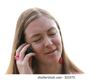 casual woman on the phone receiving bad news