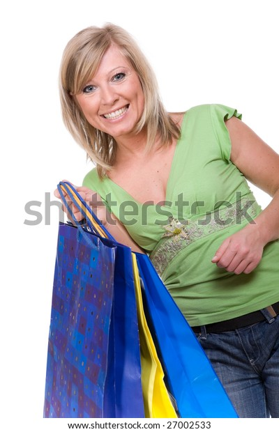 casual woman with shopping bags. over white background