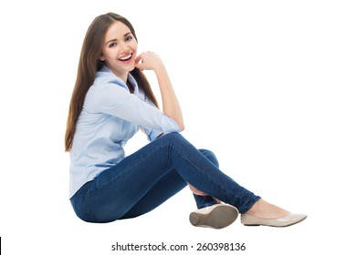 Casual woman sitting over white background