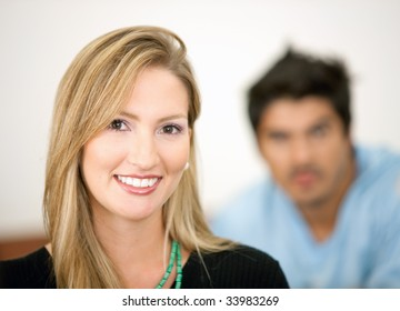 casual woman smiling with her friend behind her
