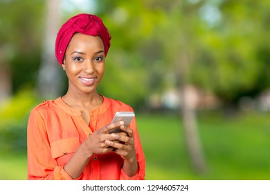 Casual woman texting on phone