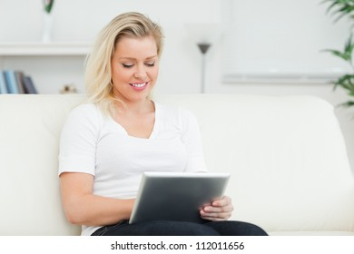 Casual woman using a tablet pc in a living room