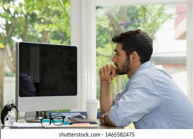 casual working man work at private place like home in front of computer seem to be entrepreneur or owner