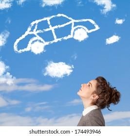 Casual young girl looking at car cloud on a blue sky