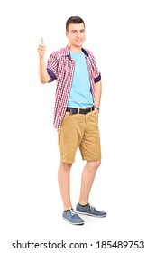 Casual young guy giving thumb up isolated on white background