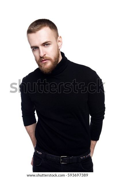 Casual young man in black clothes. Isolated over white. Men's beauty, fashion.