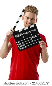 Casual young man holding a clapboard, over a white background