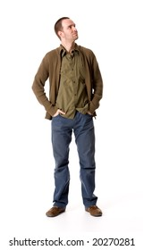 Casual young man looking up, hands in pockets
